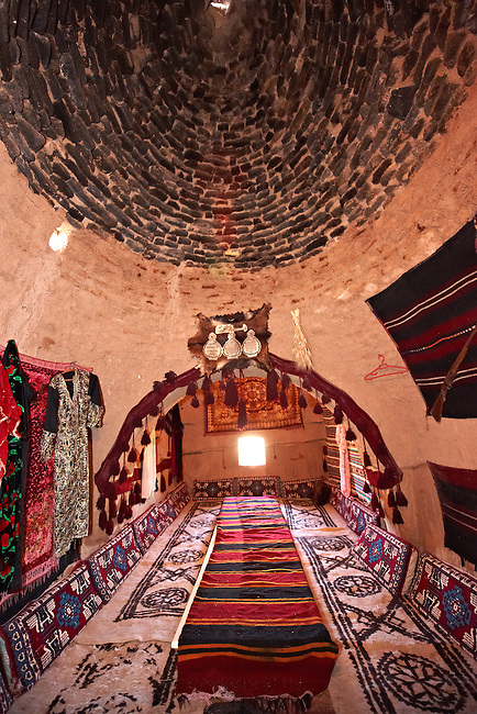 "Pictures of the beehive adobe buildings of Harran, south west Anatolia, Turkey.  Harran was a major ancient city in Upper Mesopotamia whose site is near the modern village of Altınbaşak, Turkey, 24 miles (44 kilometers) southeast of Şanlıurfa. The location is in a district of Şanlıurfa Province that is also named ""Harran"". Harran is famous for its traditional 'beehive' adobe houses, constructed entirely without wood. The design of these makes them cool inside.  6"