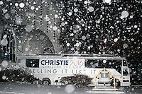 The campaign bus of Republican presidential candidate and New Jersey governor Chris Christie stands parked in the snow as the candidate holds his final New Hampshire town hall of the primary election at the St. George Greek Orthodox Cathedral in Manchester, New Hampshire, on Mon., Feb., 8, 2016.