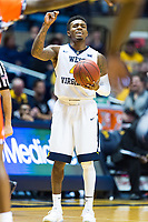 Morgantown, WV - NOV 18, 2017: West Virginia Mountaineers guard Daxter Miles Jr. (4) calls out the offensive play during game between West Virginia and Morgan State at WVU Coliseum Morgantown, West Virginia. (Photo by Phil Peters/Media Images International)