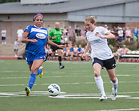 In a National Women's Soccer League Elite (NWSL) match, Portland Thorns FC defeated the Boston Breakers, 2-1, at Dilboy Stadium on July 21, 2013.  Boston Breakers forward Sydney Leroux (2) and Portland Thorns FC defender Rachel Buehler (16) converge on the ball.
