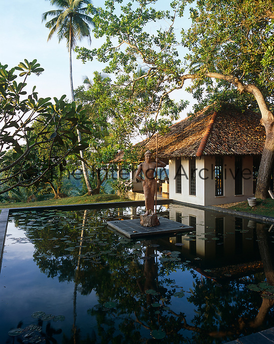 A sculpture of the King of Kandy stands in the centre of a lily pond between the master bedroom and the drawing room