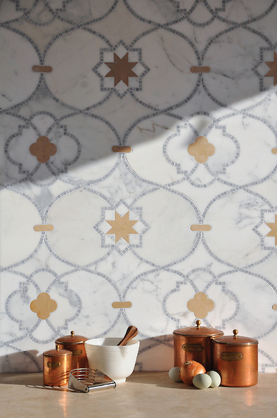 Vittoria, a handmade mosaic shown in honed Lagos Gold and polished Calacatta Tia and Allure is part of the Miraflores collection by Paul Schatz for New Ravenna.