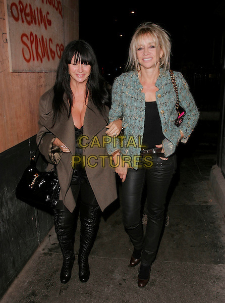 FRAN CUTLER & JO WOOD.Seen leaving the White Cube gallery after party, Dean Street, London, England, October 14th 2008..full length fringe brown coat green jacket black trousers leather pants bag lace-up boots .CAP/AH.©Adam Houghton/Capital Pictures