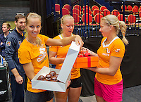April 16, 2015, Netherlands, Den Bosch, Maaspoort, Fedcup Netherlands-Australia,  Arantxa Rus, Kiki Bertens and Michaëla Krajicek, (l.t.r.) prepare to give some presents to Richel Hogenkamp on her birthday<br /> Photo: Tennisimages/Henk Koster