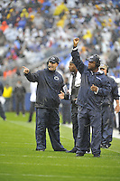 21 September 2013:  Penn State head coach Bill O'Brien and assistant head coach Stan Hixon signal in calls to the field. The Penn State Nittany Lions defeated the Kent State Golden Flashes 34-0 at Beaver Stadium in State College, PA.