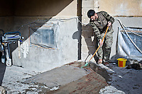 Syria, Kobane: cleaning the blood of the wounded fighter that has been evacuated.<br /> <br /> Syria,Kobane: nettoyage du sang du combattant blessé qui vient d'être évacué.