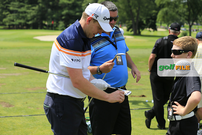 Stephen Gallacher (SCO) with 12 year old son Jack on the range during Saturday's Round 3 of the 2013 Bridgestone Invitational WGC tournament held at the Firestone Country Club, Akron, Ohio. 3rd August 2013.<br /> Picture: Eoin Clarke www.golffile.ie