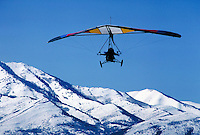 Hanglider converted into an ultralight aircraft in a clear blue sky above Cedar Valley Airport.sports, aviation, mountains  Connotations - Freedom, daring, bravado. Utah, Cedar Valley.