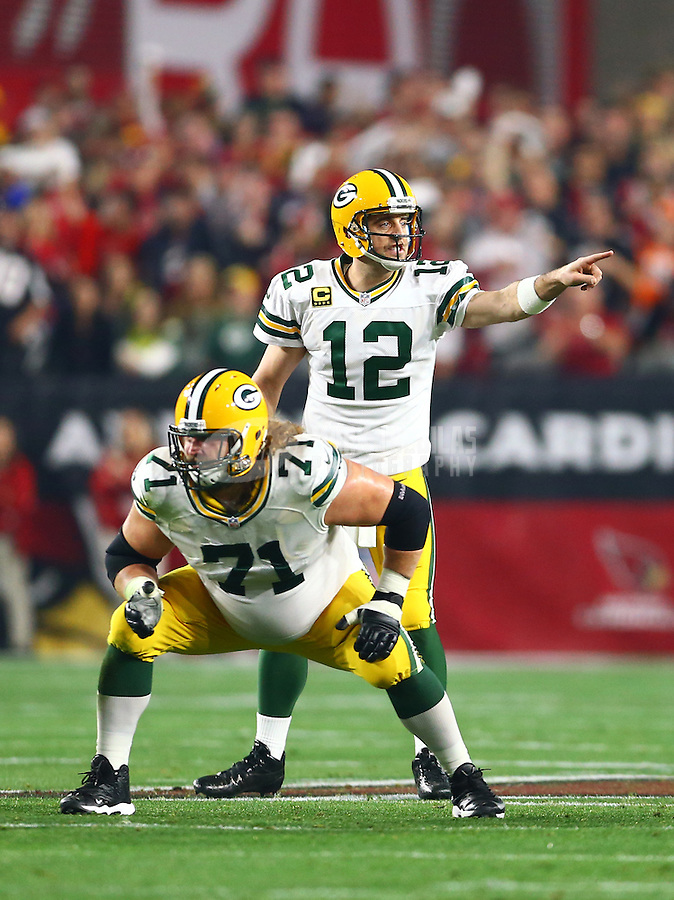 Jan 16, 2016; Glendale, AZ, USA; Green Bay Packers quarterback Aaron Rodgers (12) reacts against the Arizona Cardinals in the first quarter of a NFC Divisional round playoff game at University of Phoenix Stadium. Mandatory Credit: Mark J. Rebilas-USA TODAY Sports