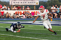 Fort Smith Northside quarterback Dreyden Norwood escapes Greenwood defender Jordan Hanna in the first quarter of Friday's game in Greenwood.