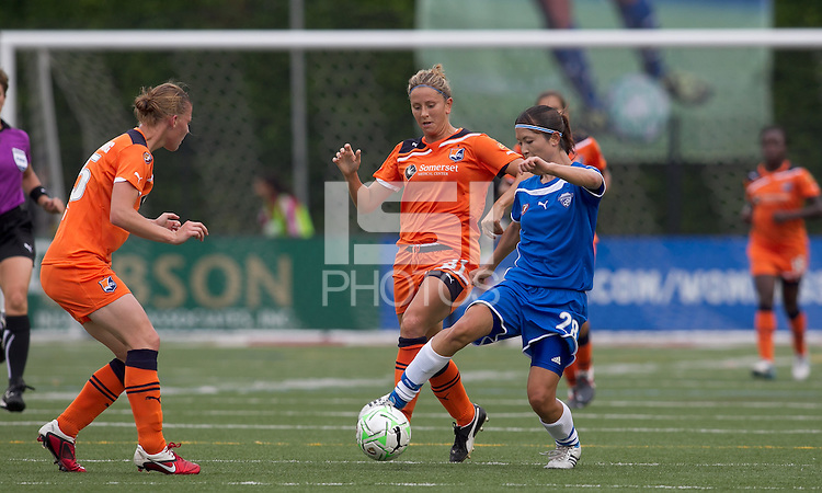 Boston Breakers defender Aya Sameshima (28) dribbles as Sky Blue FC midfielder Carolyn Blank (31) pressures. In a Womens Professional Soccer (WPS) match, the Boston Breakers defeated Sky Blue FC, 2-0, at Harvard Stadium on August 14, 2011 and gained the last playoff slot.