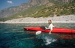 Crete, Greece, sea kayakeer, splashing, southwest coast of Crete, Mediterranean Sea, Europe, sheer exhuberance, Joel Rogers, released,.