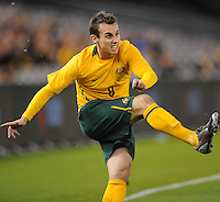 MELBOURNE, AUSTRALIA - OCTOBER 14: Luke Wilkshire from Australia crosses the ball in a AFC Asian Cup 2011 match between Australia and Oman at Etihad Stadium on October 14, 2009 in Melbourne, Australia. Photo Sydney Low www.syd-low.com