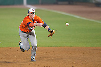 Auburn Tigers first baseman Garrett Cooper #28 tosses the ball to the pitcher covering first base against the LSU Tigers in the NCAA baseball game on March 23, 2013 at Alex Box Stadium in Baton Rouge, Louisiana. LSU defeated Auburn 5-1. (Andrew Woolley/Four Seam Images).