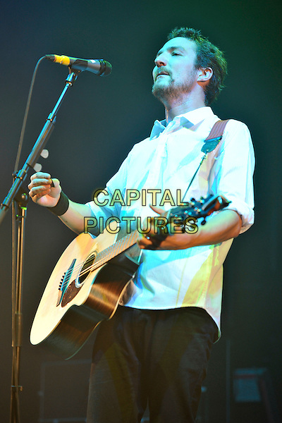 FRANK TURNER.Performing live at Brixton Academy, London, England..December 12th, 2010.stage concert live gig performance music half length white shirt guitar .CAP/MAR.© Martin Harris/Capital Pictures.