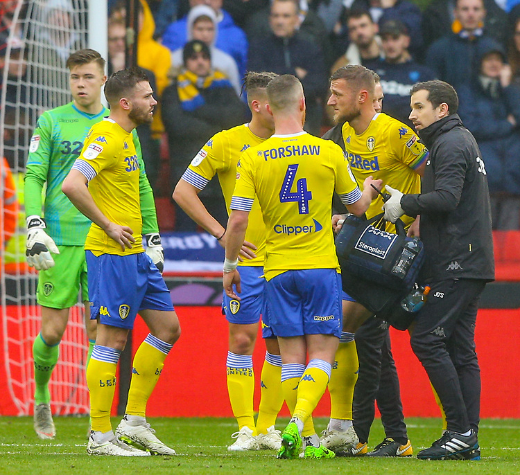 Leeds United's Liam Cooper is helped from the field after suffering an injury<br /> <br /> Photographer Alex Dodd/CameraSport<br /> <br /> The EFL Sky Bet Championship - Sheffield United v Leeds United - Saturday 1st December 2018 - Bramall Lane - Sheffield<br /> <br /> World Copyright © 2018 CameraSport. All rights reserved. 43 Linden Ave. Countesthorpe. Leicester. England. LE8 5PG - Tel: +44 (0) 116 277 4147 - admin@camerasport.com - www.camerasport.com