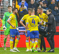 Leeds United's Liam Cooper is helped from the field after suffering an injury<br /> <br /> Photographer Alex Dodd/CameraSport<br /> <br /> The EFL Sky Bet Championship - Sheffield United v Leeds United - Saturday 1st December 2018 - Bramall Lane - Sheffield<br /> <br /> World Copyright &copy; 2018 CameraSport. All rights reserved. 43 Linden Ave. Countesthorpe. Leicester. England. LE8 5PG - Tel: +44 (0) 116 277 4147 - admin@camerasport.com - www.camerasport.com