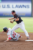 Christian Stringer (8) of the Kannapolis Intimidators gets out of the way of a sliding Mitch Walding (22) of the Lakewood BlueClaws after getting the force out at second base at CMC-NorthEast Stadium on July 20, 2014 in Kannapolis, North Carolina.  The Intimidators defeated the BlueClaws 7-6. (Brian Westerholt/Four Seam Images)
