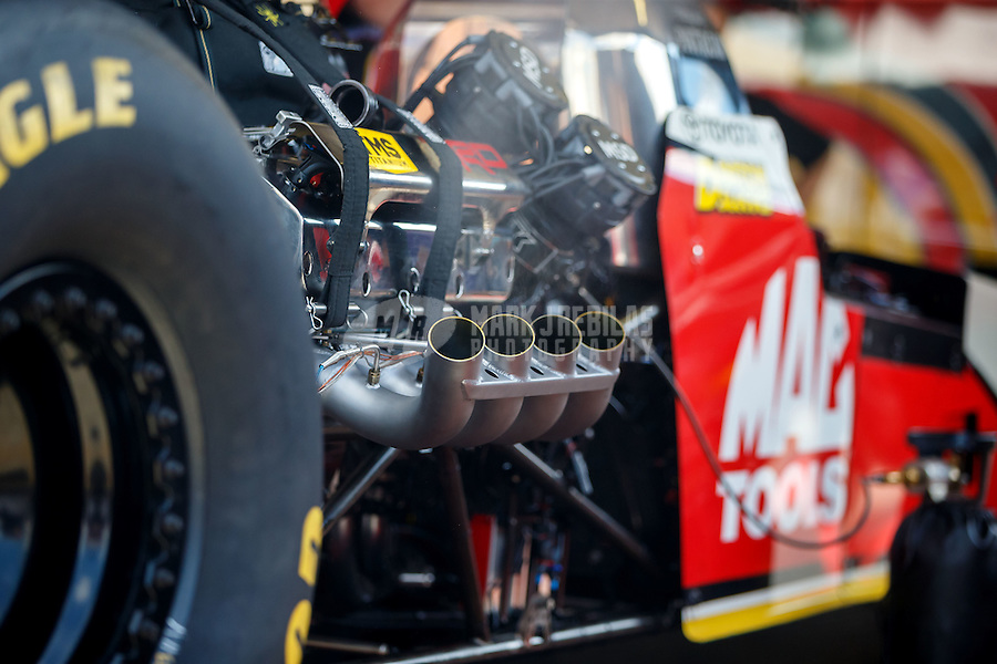 Sep 3, 2016; Clermont, IN, USA; Detailed view of the header pipes on the engine of NHRA top fuel driver Doug Kalitta during qualifying for the US Nationals at Lucas Oil Raceway. Mandatory Credit: Mark J. Rebilas-USA TODAY Sports