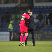 2nd December 2017, Global Energy Stadium, Dingwall, Scotland; Scottish Premiership football, Ross County versus Dundee; Dundee manager Neil McCann hugs Dundee goalkeeper Elliott Parish after the match