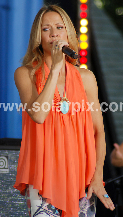 **ALL ROUND PICTURES FROM SOLARPIX.COM**.**SYNDICATION RIGHTS FOR UK, AUSTRALIA, DENMARK, PORTUGAL, S. AFRICA, SPAIN & DUBAI (U.A.E) & ASIA (EXCLUDING JAPAN) ONLY**.Good Morning America - Sheryl Crow in Concert, Central Park Summer Stage, NY, USA, 23 July 2010.This pic: Sheryl Crow.JOB REF: 11758 PHZ Giacomazzo  DATE: 23_07_2010.**MUST CREDIT SOLARPIX.COM OR DOUBLE FEE WILL BE CHARGED**.**MUST NOTIFY SOLARPIX OF ONLINE USAGE**.**CALL US ON: +34 952 811 768 or LOW RATE FROM UK 0844 617 7637**