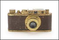 BNPS.co.uk (01202 558833)<br /> Picture: Bonhams/BNPS<br /> <br /> ****Please use full byline****<br /> <br /> Leica Luxis II without case.<br /> <br /> The only surviving model of an incredibly rare Leica camera could sell for a world record price of more than &pound;1.7 million.<br /> <br /> The Luxus II camera is gold plated and encased in fake lizard skin and was one of just four special edition versions made in 1932.<br /> <br /> The camera has the serial number 88840 and comes with a 50mm Elmar lens, which features a bell-push release.<br /> <br /> The model is now thought to be the rarest camera in existence as the whereabouts of the other three is unknown.<br /> <br /> It is also being sold with an orginal crocodile camera case, the first time one has ever come to light.<br /> <br /> Auctioneers expect the camera could fetch a seven figure sum when it goes under the hammer after a Leica 0 series sold for almost two million pounds last year.<br /> <br /> Leica, formerly known as Ernst Leitz GmbH, made their first camera in 1913 which was designed for landscape photography.<br /> <br /> The brand went on to become one of the most iconic camera manufacturers because of their small, compact models in contrast to the large versions available at the time.