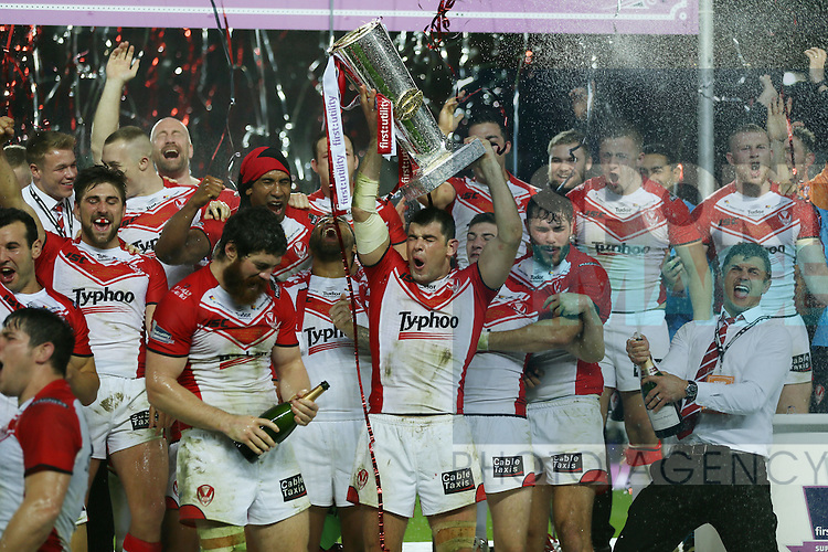 St Helens Paul Wellens celebrates with the trophy- First Utility Super League Grand Final - St Helens v Wigan Warriors - Old Trafford Stadium - Manchester - England - 11th October 2014 - Pic Paul Currie/Sportimage