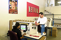 Reed Hastings, right, CEO and Co-founder of Netflix, speaks with employees at the new Phoenixville, Pennsylvania distribution center, Wednesday, February 12, 2003, in Phoenixville, Pennsylvania. Netflix plans to open one to two facilities per month for the remainder of 2003 as part of its ongoing strategy to provide one-day movie delivery to its members. By year-end 2003, Netflix expects that it will be able to reach more than 70 percent of its subscribers with generally next-day service. (Photo by William Thomas Cain)