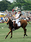 Prince Harry competing at the 3rd Annual Veuve Clicquot Polo Classic on Governors Island on June 27, 2010.