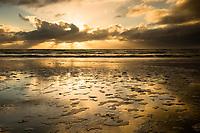 Clouds reflections on beach near New Plymouth, Taranaki Region, West Coast, North Island, New Zealand, NZ