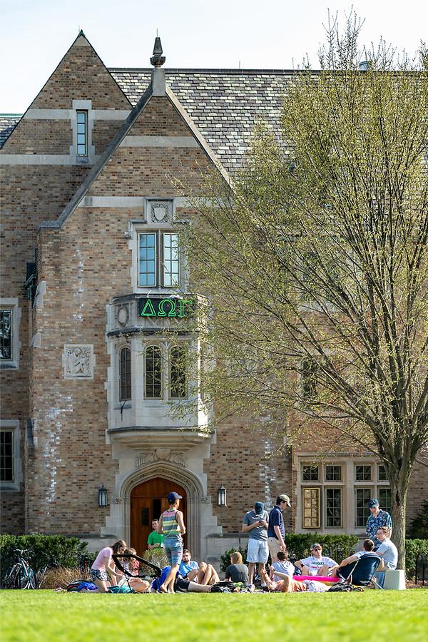 May 1, 2018; Students sit on South Quad near Alumni Hall (Photo by Matt Cashore/University of Notre Dame)