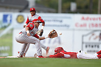 Williamsport Crosscutters shortstop Emmanuel Marrero (18) takes a throw as Mason Davis (7) slides in during the first game of a doubleheader against the Batavia Muckdogs on July 29, 2014 at Dwyer Stadium in Batavia, New York.  Williamsport defeated Batavia 3-2.  (Mike Janes/Four Seam Images)