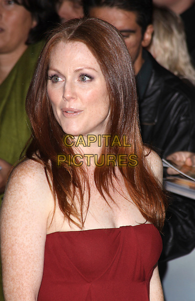 "JULIANNE MOORE.Attending the Times BFI 53rd London Film Festival Gala Screening of ""Chloe"" at Vue West End Cinema, Leicester Square, London, England, UK,.October 22nd 2009..portrait headshot  rust russet red strapless freckles.CAP/AH.©Adam Houghton/Capital Pictures."