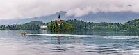 Rowers rowing by Lake Bled Island, Gorenjska, Upper Carniola Region, Slovenia, Europe