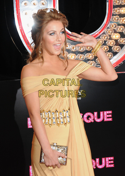 JULIANNE HOUGH.'Burlesque' Los Angeles Premiere held at The Grauman Chinese Theatre, Hollywood, CA, USA. .November 15th, 2010 .half length ruched embellished belt waistband off the shoulders beige gold hand waving mouth open clutch bag dress bracelets .CAP/RKE/DVS.©DVS/RockinExposures/Capital Pictures.