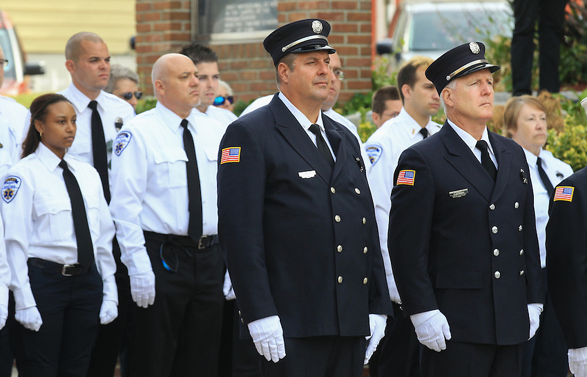 Dozens of firefighters and EMTs stand at attention at the funeral for Manasquan volunteer firefighter Dan McCann outside St. Cecilia's Church in Kearny. McCann, a firefighter EMT with more than 25 years experience, died last week after a fire department training exercise.  9/21/16  (Andrew Mills | NJ Advance Media for NJ.com)