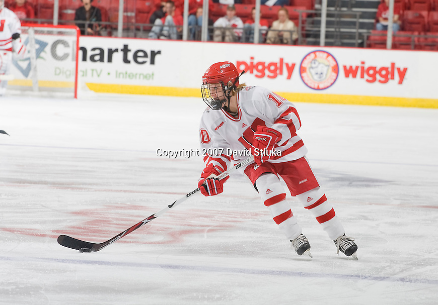 MADISON, WI - NOVEMBER 2: Kayla Hagen #10 of the Wisconsin Badgers women's hockey team handles the puck against the Minnesota Golden Gophers at the Kohl Center on November 2, 2007, in Madison, Wisconsin. The Badgers beat the Golden Gophers 3-0. (Photo by David Stluka)