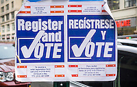 Signs encouraging voter registration in New York on Saturday, March 19, 2016.  (© Richard B. Levine)