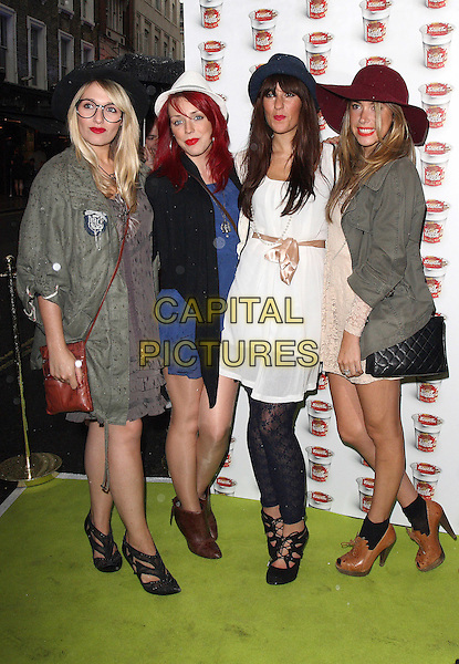SCARLETT .Sticky Rib Pot Noodle party held at the Soho Arts Theatre,  London, England, UK, August 4th 2010.full length girl group band red hat green khaki jacket parker parka brown booties shoes shooboots white blue dress hats .CAP/JIL.©Jill Mayhew/Capital Pictures