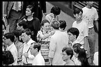 A Hong Kong Chinese woman says goodbye to a man in Central financial district, Hong Kong, 1988.