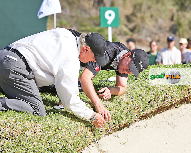 16 FEB 13  PGA Tour Rules Official John Mutch assisting Jimmy Walker with a ruling during Saturday's Third Round at The Northern Trust Open at Riviera Country Club in Pacific Palisades, California. (photo:  kenneth e.dennis / kendennisphoto.com)