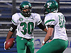 Farmingdale running back No. 30 Jordan McLune, left, gets congratulated by No. 62 Chris Demers after rushing for a touchdown in the first quarter of the Nassau County varsity football Conference I final against Oceanside at Hofstra University on Saturday, Nov. 21, 2015.<br /> <br /> James Escher
