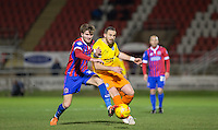 Paul Hayes of Wycombe Wanderers plays a pass past Oliver Muldoon of Dagenham & redbridge during the Sky Bet League 2 match between Dagenham and Redbridge and Wycombe Wanderers at the London Borough of Barking and Dagenham Stadium, London, England on 9 February 2016. Photo by Andy Rowland.