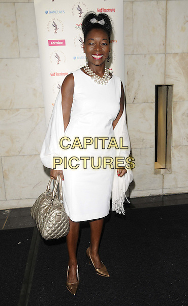 Floella Benjamin.The Women Of The Year Lunch, Intercontinental hotel, Park Lane, London, England..October 17th, 2011.full length white sleeveless dress wrap shawl gold shoes bag purse .CAP/CAN.©Can Nguyen/Capital Pictures.