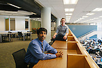 """College and university libraries have been experimenting with so-called """"Walden Zones"""" or deep quiet areas, designed to help students work free of the distractions of technology...Ameet Doshi (seen in blue), the user experience librarian at Georgia Tech Library, is seen in a quiet zone with rising Georgia Tech junior Ian Bailie at the Atlanta university June 28, 2012"""