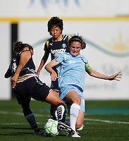 Heather O'Reilly (9) of Sky Blue FC and Stephanie Cox (14) of the Los Angeles Sol battle for the ball. The Los Angeles Sol defeated Sky Blue FC 2-0 during a Women's Professional Soccer match at TD Bank Ballpark in Bridgewater, NJ, on April 5, 2009. Photo by Howard C. Smith/isiphotos.com