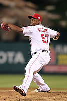 Los Angeles Angels pitcher Jerome Williams #57 pitches against the Oakland Athletics at Angel Stadium on September 24, 2011 in Anaheim,California. Los Angeles defeated Oakland 4-2.(Larry Goren/Four Seam Images)