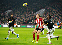 Sheffield United's Phil Jagielka shields the ball from Manchester United's Aaron Wan-Bissaka <br /> <br /> Photographer Alex Dodd/CameraSport<br /> <br /> The Premier League - Sheffield United v Manchester United - Sunday 24th November 2019 - Bramall Lane - Sheffield<br /> <br /> World Copyright © 2019 CameraSport. All rights reserved. 43 Linden Ave. Countesthorpe. Leicester. England. LE8 5PG - Tel: +44 (0) 116 277 4147 - admin@camerasport.com - www.camerasport.com
