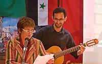 Ella Rule and Carlos Martinez-Brar on guitar at the.Memorial Meeting honouring Godfrey Cremer's life, Saklatvala Hall, Southall, 12th May 2012