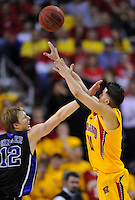 Greivis Vasquez of the Terrapins gets a hand to face as he shoots the ball. Maryland defeated Duke 79-72 at the Comcast Center in College Park, MD on Wednesday, March 3, 2010. Alan P. Santos/DC Sports Box